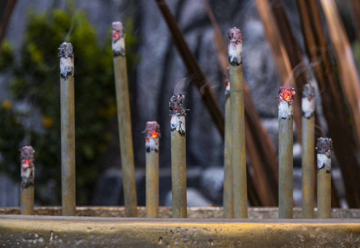 Incense smokes about copper leaves as the Bellagio Conservatory & Botanical Gardens debut its d ...