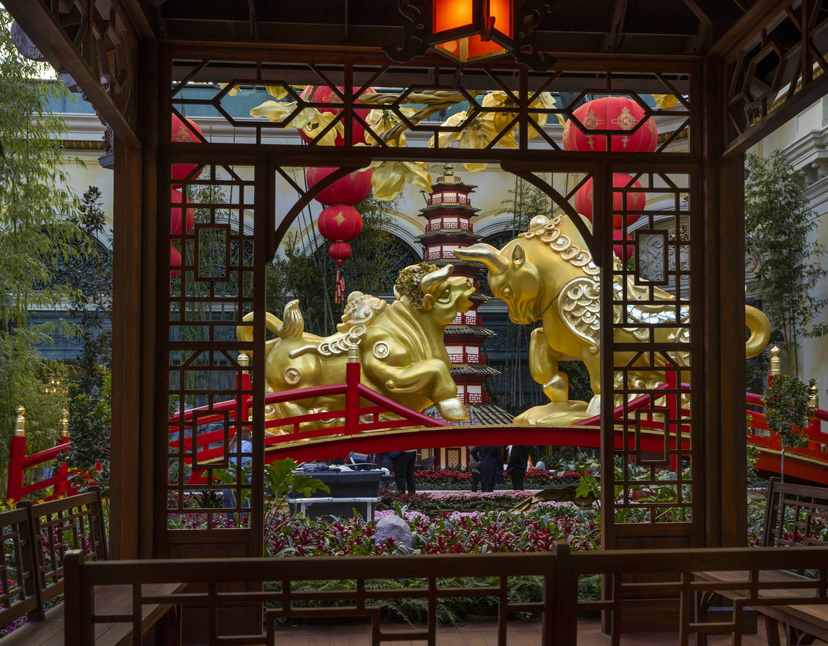 A gazebo and golden ox couple looking at each other lovingly as the Bellagio Conservatory & Bot ...