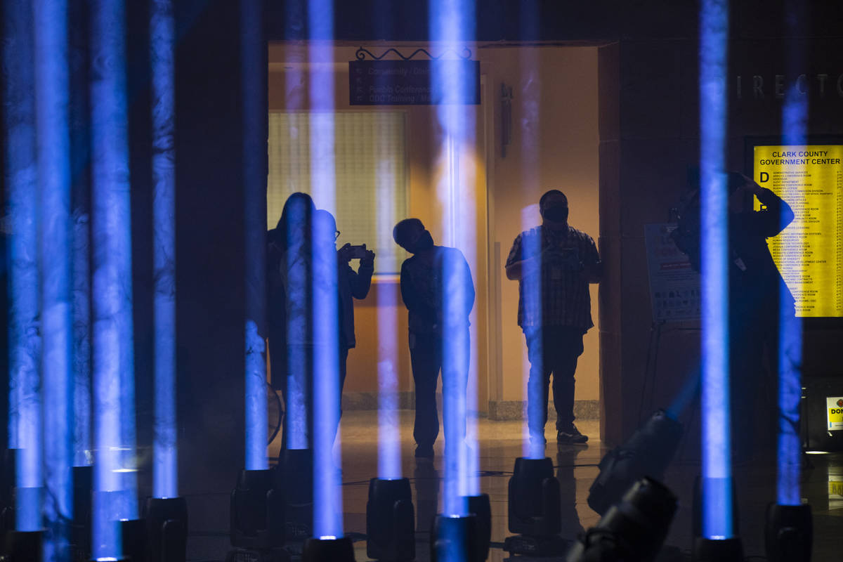 People record with their phones as 29 illuminate the rotunda at the Clark County Government Cen ...