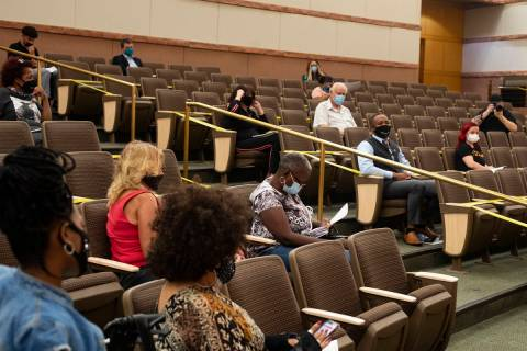 The socially distant crowd at a town hall for pandemic-related housing issues at the Clark Coun ...