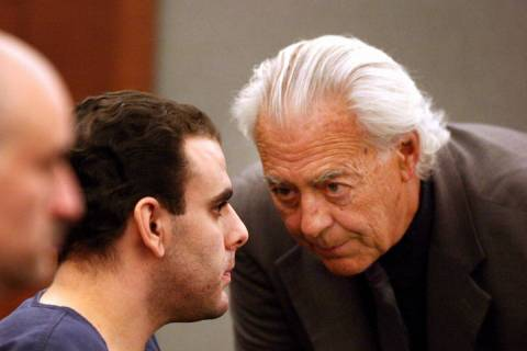 Attorney Bill Terry, right, talks with his client Anthony Carleo in Clark County District Court ...