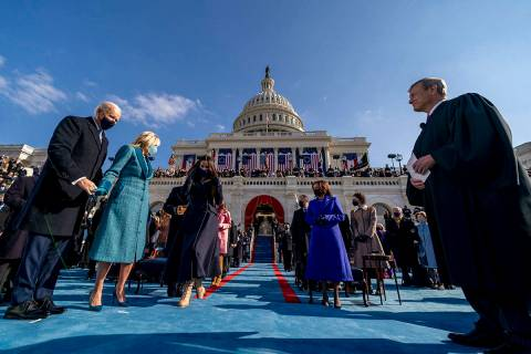 Joe Biden takes the stage to be sworn in as the 46th president of the United States by Chief Ju ...