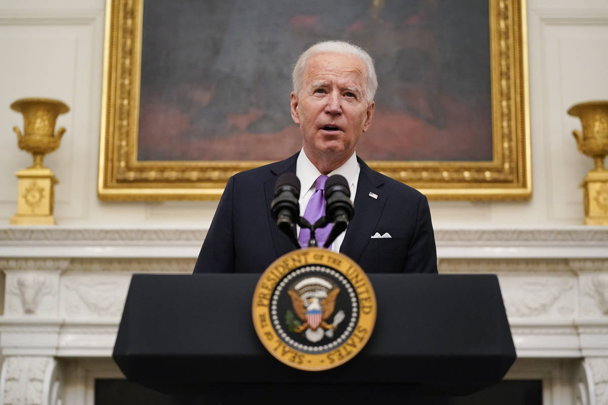 President Joe Biden speaks about the coronavirus in the State Dinning Room of the White House, ...