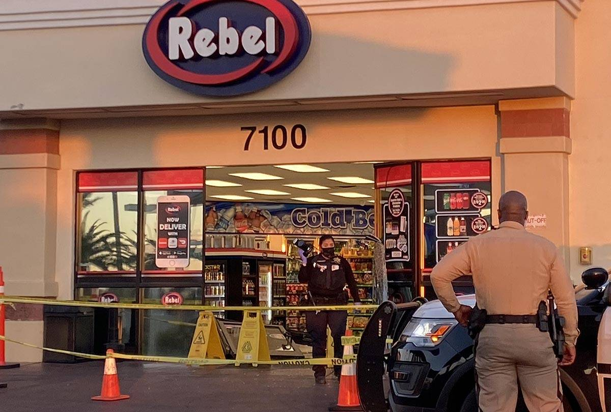 Las Vegas police investigate where a man drove his vehicle into the front doors of an Arco Rebe ...