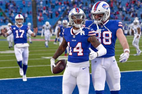 Buffalo Bills wide receiver Stefon Diggs (14) celebrates with tight end Dawson Knox (88) after ...