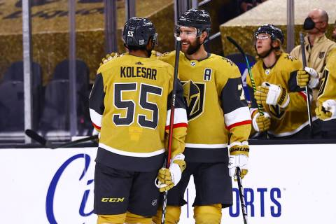 Golden Knights defenseman Alex Pietrangelo (7) celebrates his goal with right wing Keegan Koles ...