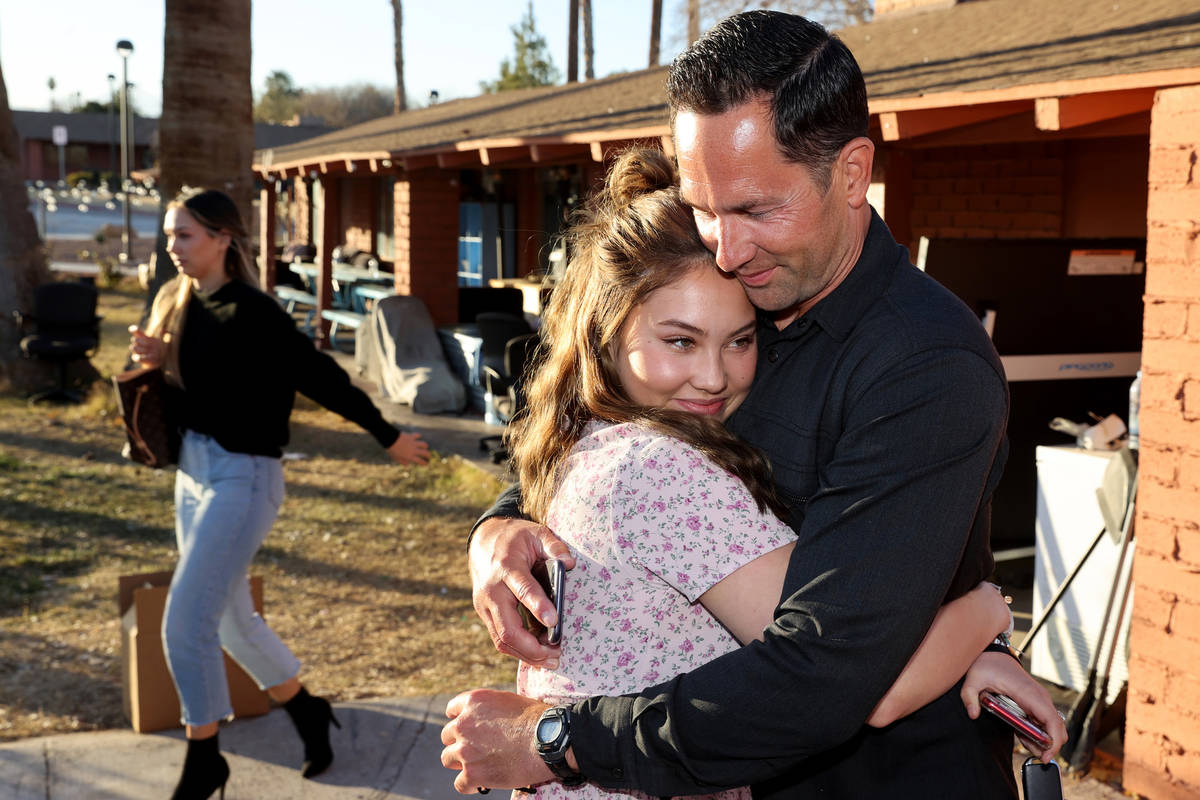 Kyle Kimoto gets a hug from his daughter Kahlea Kimoto, 20, at Jewel's Marty Hennessy Inspiring ...