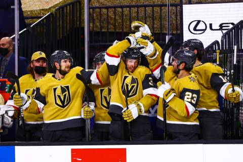The Golden Knights celebrate a goal by right wing Alex Tuch, not pictured, during the third per ...