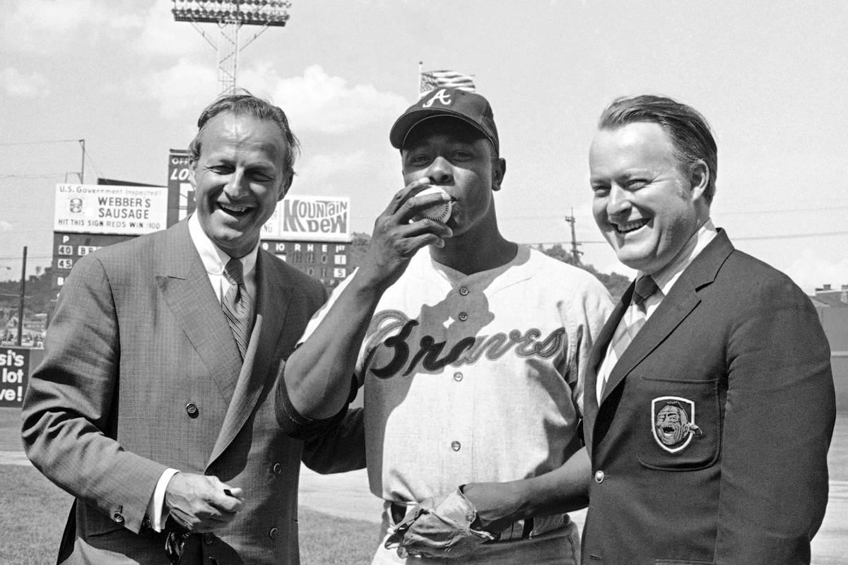 FILE - In this May 17, 1970, file photo, Atlanta Braves' Hank Aaron, center, who became the nin ...