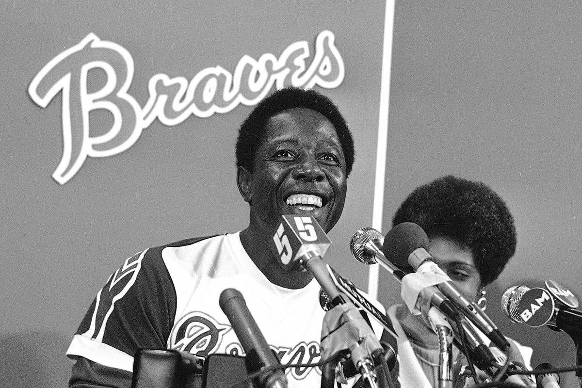 FILE - Atlanta Braves' Hank Aaron smiles during a press conference at Atlanta Stadium, Ga., aft ...