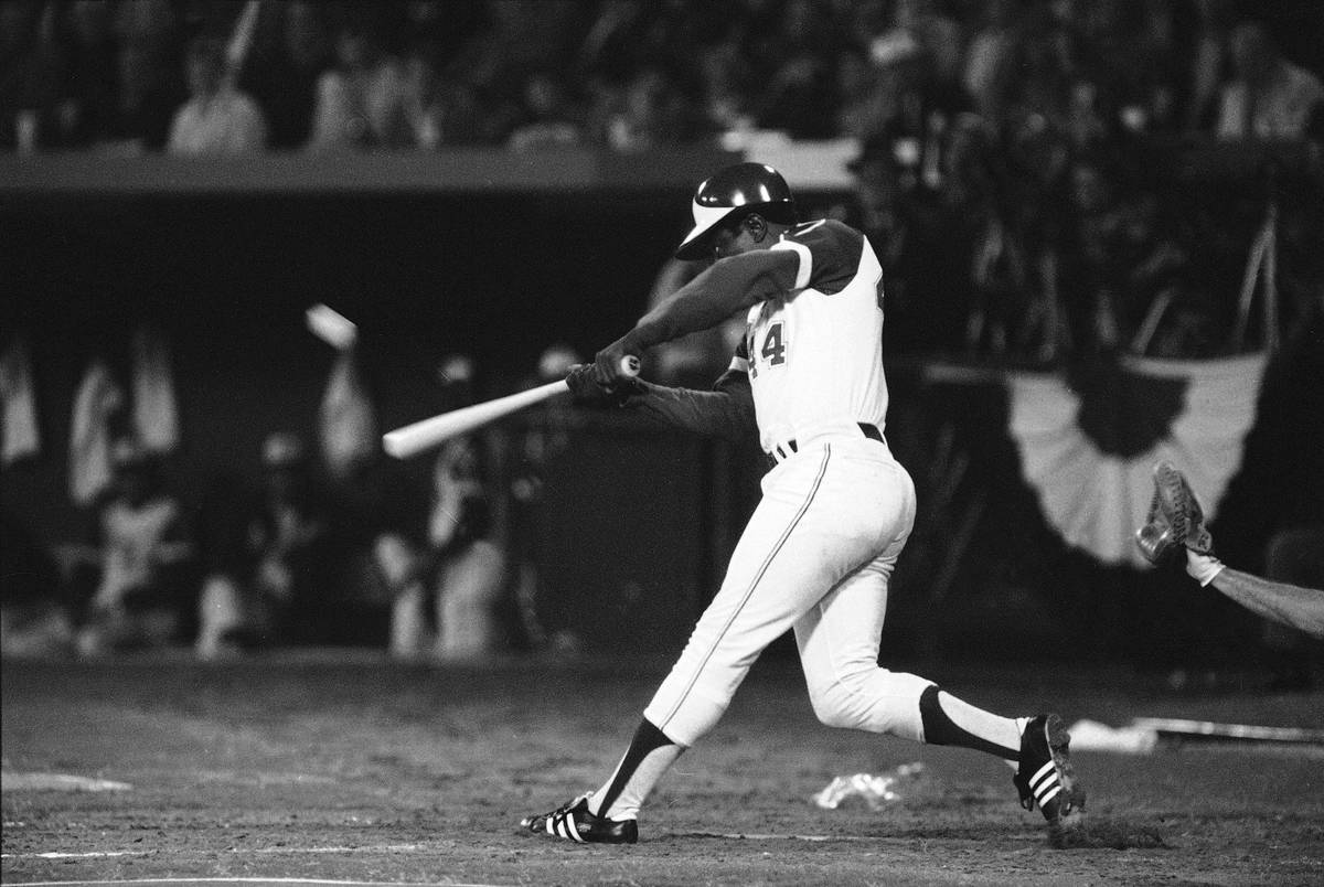 FILE - In this April 8, 1974, file photo, Atlanta Braves' Hank Aaron hits his 715th career home ...