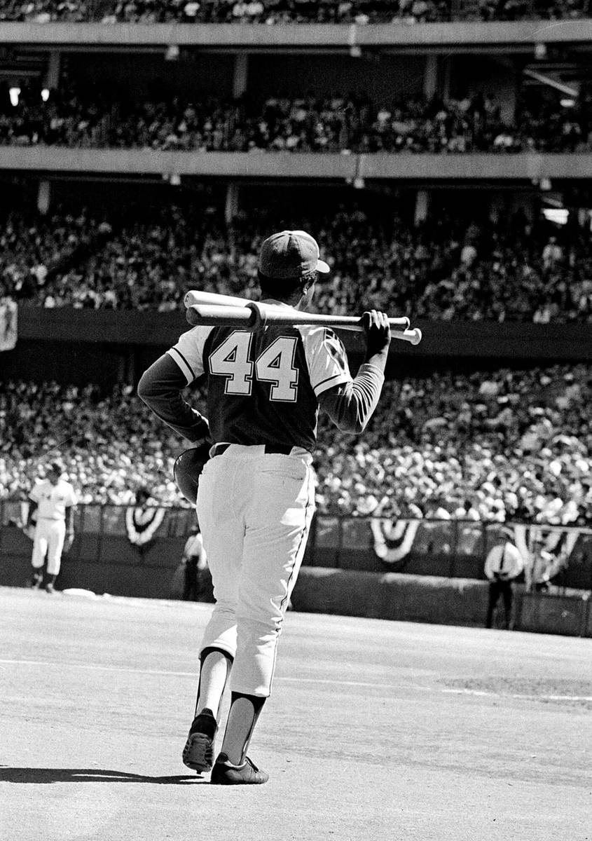 FILE*** HISTORIC *** Atlanta Braves' right-handed slugger Hank Aaron (44) walks out from the b ...