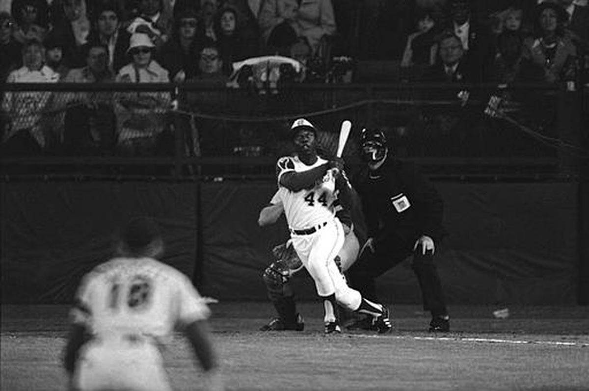 Hank Aaron hits his 715th career home run on April 18, 1974, topping Babe Ruth's record. (AP file)