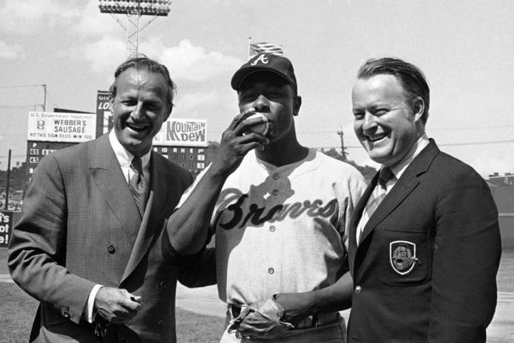 FILE- In this May 17, 1970, file photo Atlanta Braves' Hank Aaron, center, poses for photos aft ...