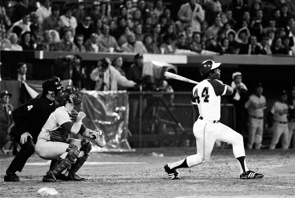 Atlanta Braves' Hank Aaron (44) breaks Babe Ruth's record for career home runs as he hits his 7 ...