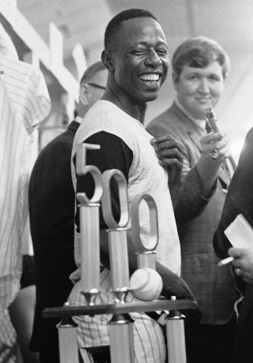 FILE- In this July 14, 1968, file photo, Atlanta Braves' Hank Aaron smiles as he looks at the t ...