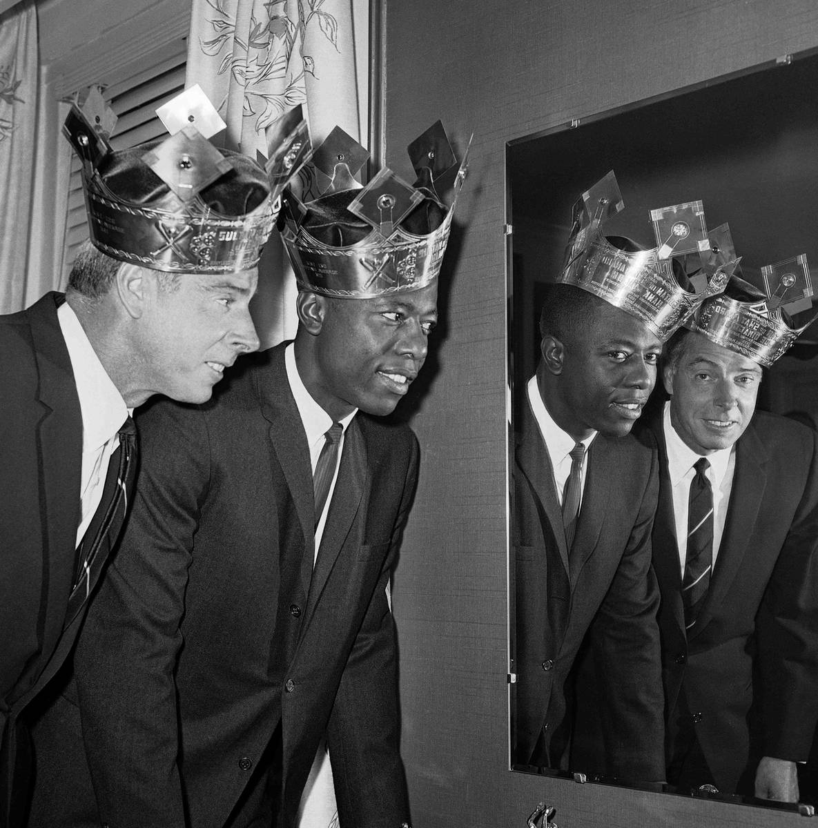 Joe DiMaggio and Hank Aaron, wearing their Sultan of Swat crowns at rakish angles, pose with th ...