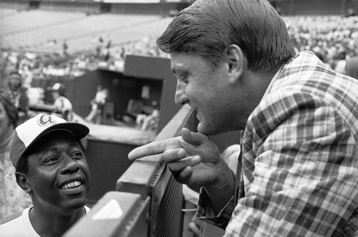 Former Yankee star Roger Maris talks with Hank Aaron on July 17, 1973, in Atlanta. Maris says h ...