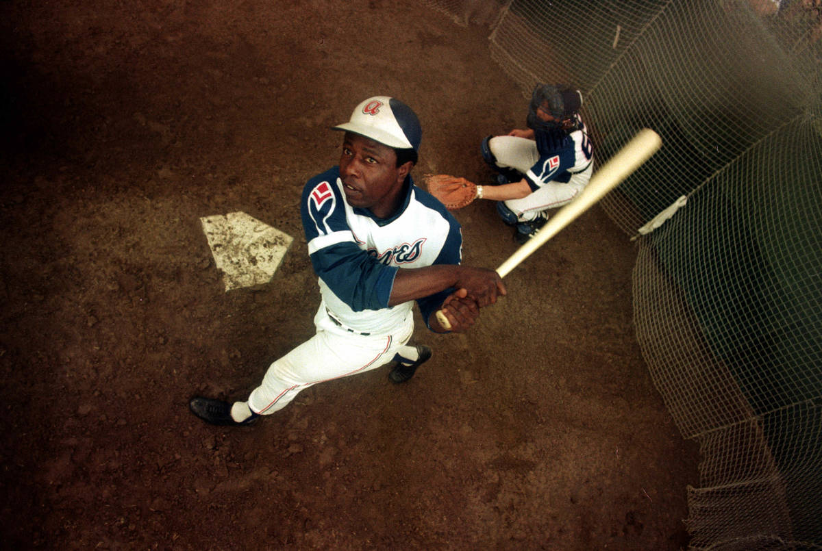 FILE- In this March 1974 file photo, Atlanta Braves outfielder Hank Aaron swings a bat at home ...