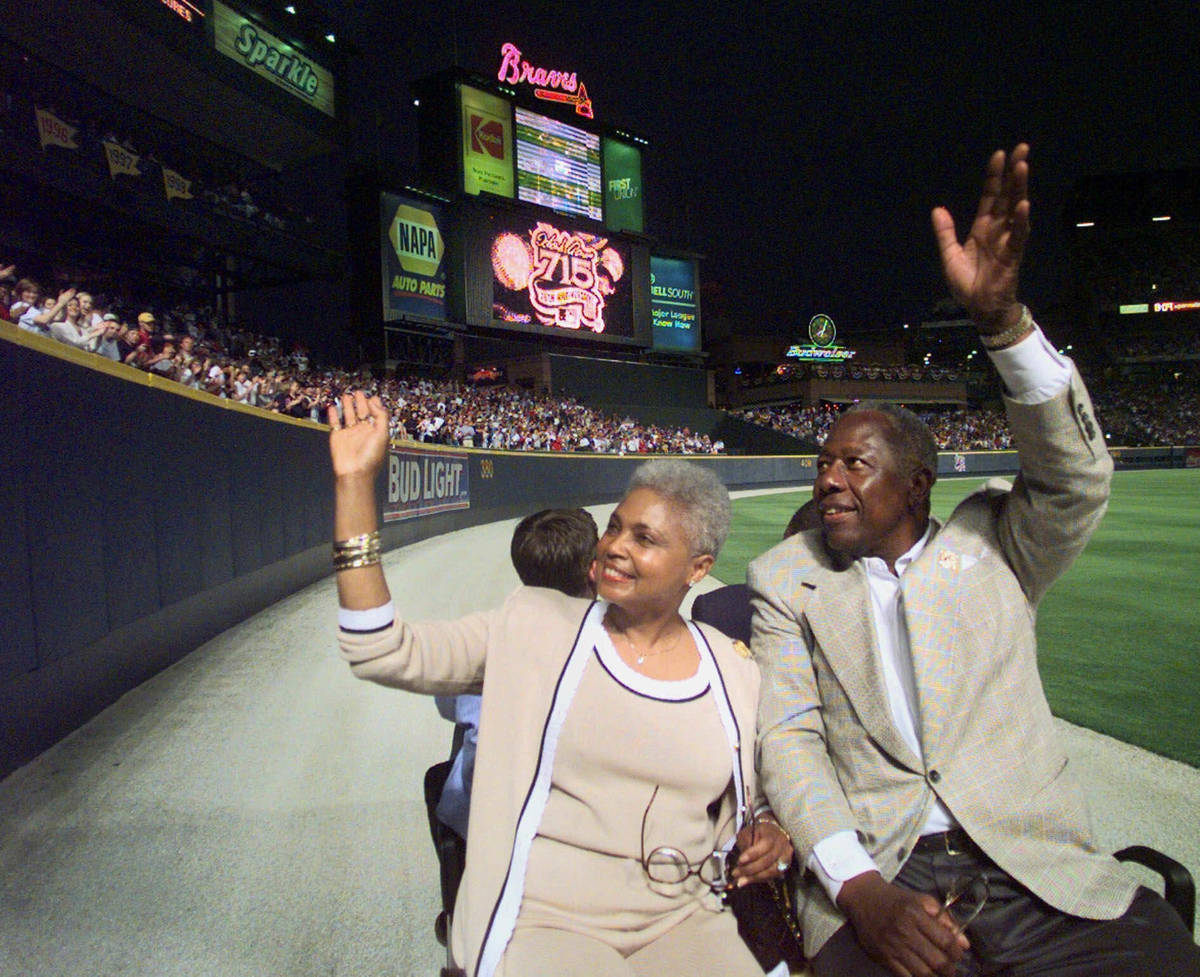 Major League Baseball's all-time career home run record holder Hank Aaron and his wife Billye t ...