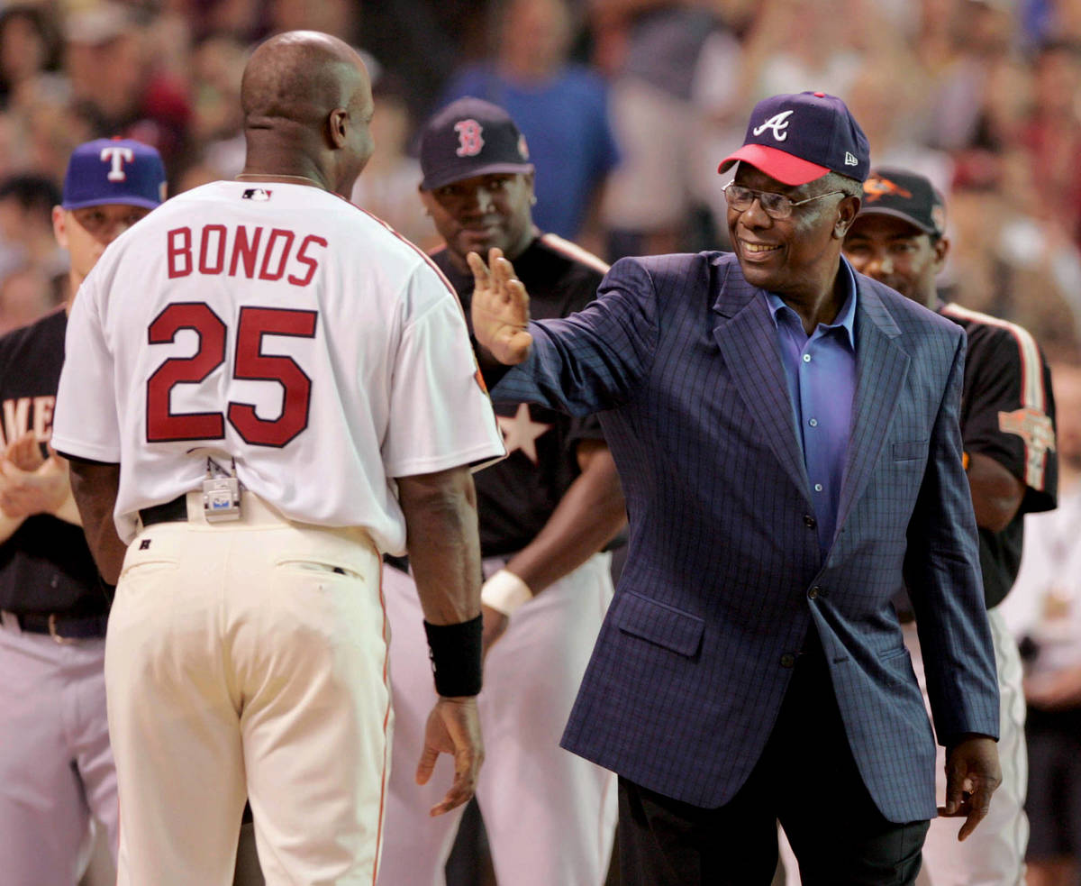 FILE- In this July 12, 2004, file photo, home run record holder Hank Aaron greets San Francisco ...