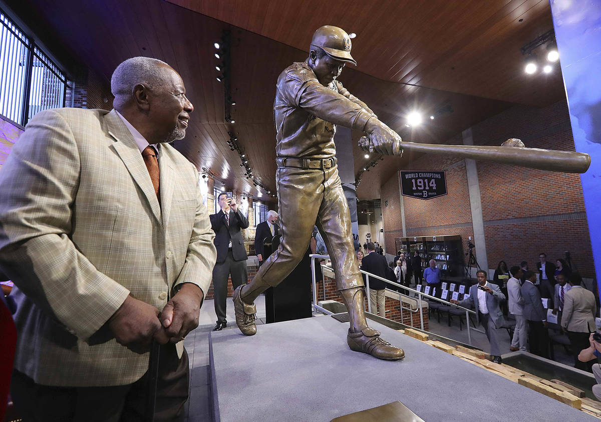FILE- In this March 29, 2017, file photo, Hank Aaron looks at his new statue in Monument Garde ...