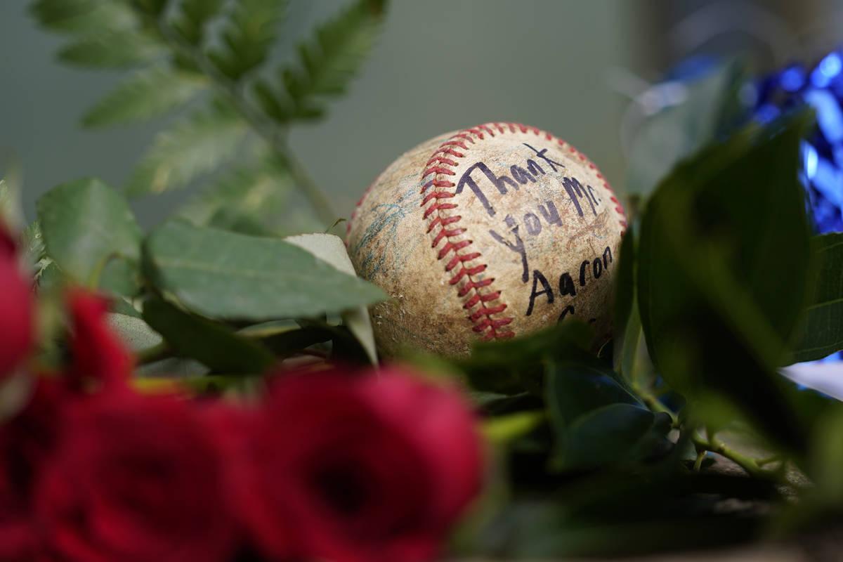 A baseball left by a fan rests in a growing memorial Friday, Jan. 22, 2021, in Atlanta, near th ...