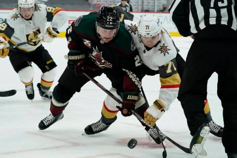 Arizona Coyotes left wing Johan Larsson (22) and Vegas Golden Knights center William Karlsson ( ...