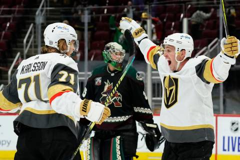Vegas Golden Knights center William Karlsson (71) celebrates with center Jonathan Marchessault ...