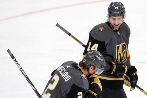Golden Knights' defenseman Nicolas Hague (14) celebrates with defenseman Zach Whitecloud (2) af ...