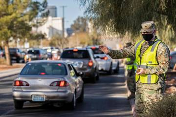 Army National Guard members direct traffic at the COVID-19 testing center at the UNLV Stan Fult ...
