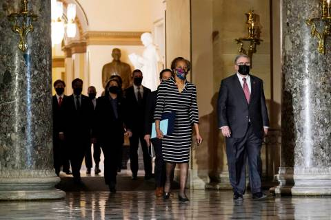 Clerk of the House Cheryl Johnson along with acting House Sergeant-at-Arms Tim Blodgett, lead t ...