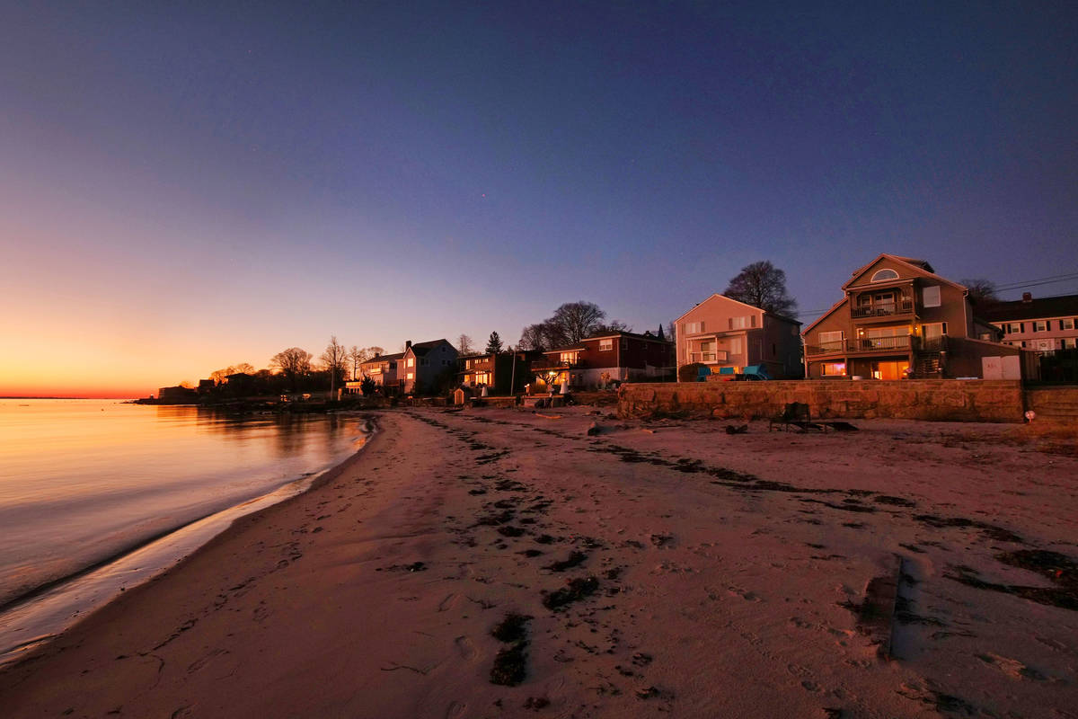 The early morning sun lights up the home at 500 Pequot Ave, right, along the Thames River, pict ...