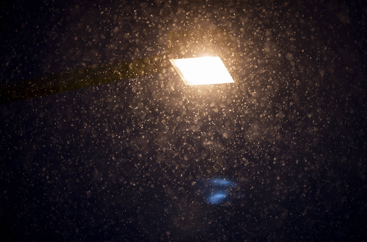 Snow flurries come down in Summerlin near Gardens Park on Tuesday, Jan. 26, 2021, in Las Vegas ...