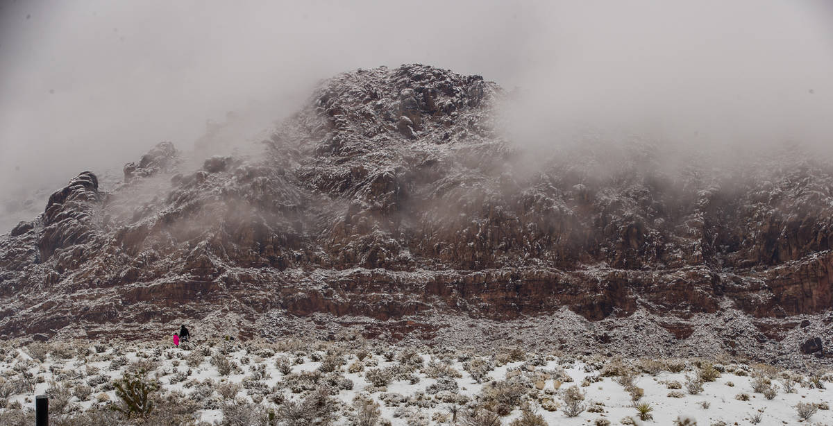People play in the snow about Calico Basin in the Red Rock Conservation Area on Tuesday, Jan. 2 ...