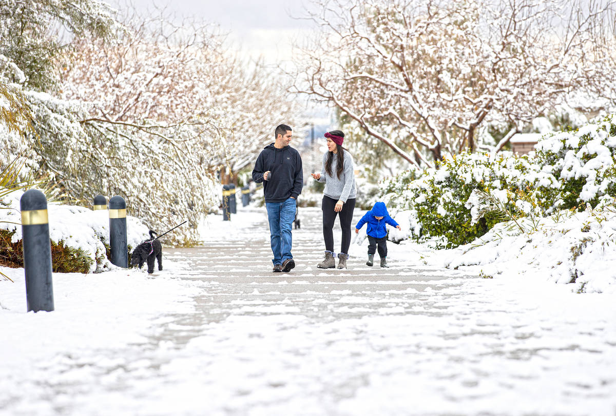 Grayson Mahar, 3, right, walks with his parents Ally and Sam along The Promenade in northwest L ...