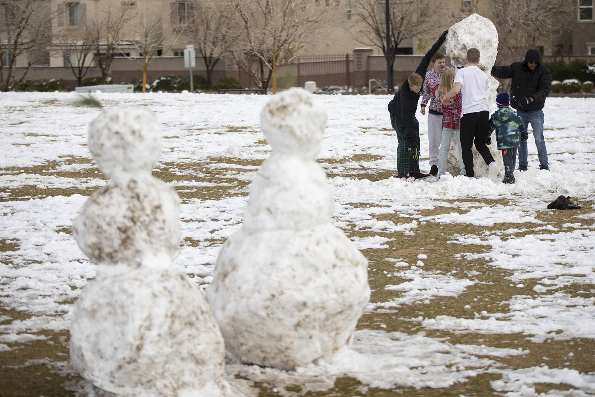 People play with the snow at Huckleberry Park in Las Vegas, on Tuesday, Jan. 26, 2021. (Erik Ve ...