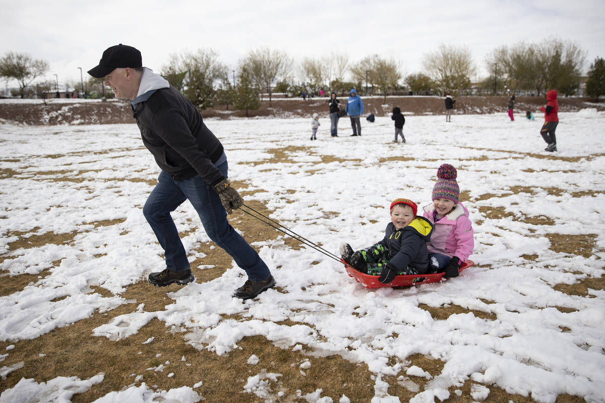 Darrin Goheen plays with his children Lucas, 3 and Riley, 5, at Huckleberry Park in Las Vegas, ...