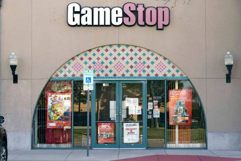 A GameStop storefront is shown before opening Thursday morning, Jan. 28, 2021, in Dallas. The ...