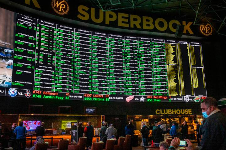 The Westgate sportsbook posts hundreds of Super Bowl prop bets and the line of bettors forms on ...