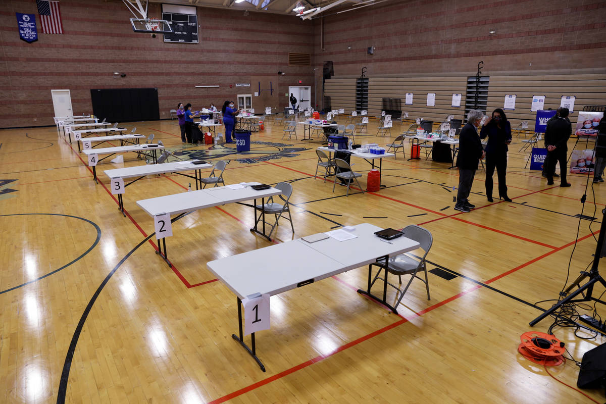 Southern Nevada Health District officials prepare for a COVID-19 pop-up vaccination clinic at M ...