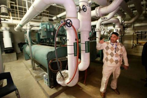 Clark County School District Operations Manager Douglas Diaz explains the central cooling plant ...