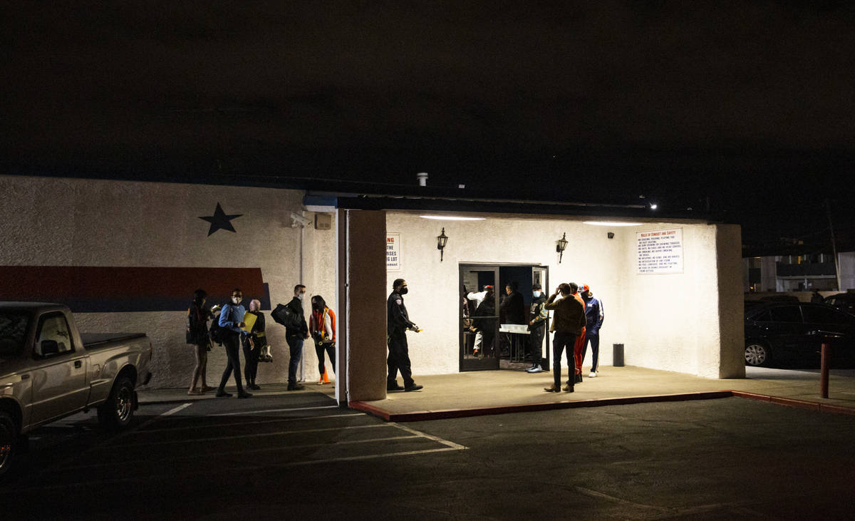 People wait in line to enter the Crystal Palace roller rink, which was purchased by boxing lege ...