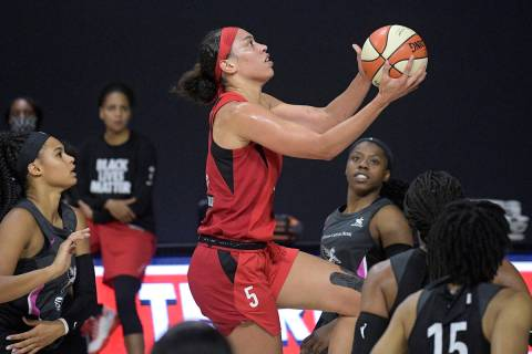 Las Vegas Aces forward Dearica Hamby goes up for a shot during the first half of the team's WNB ...