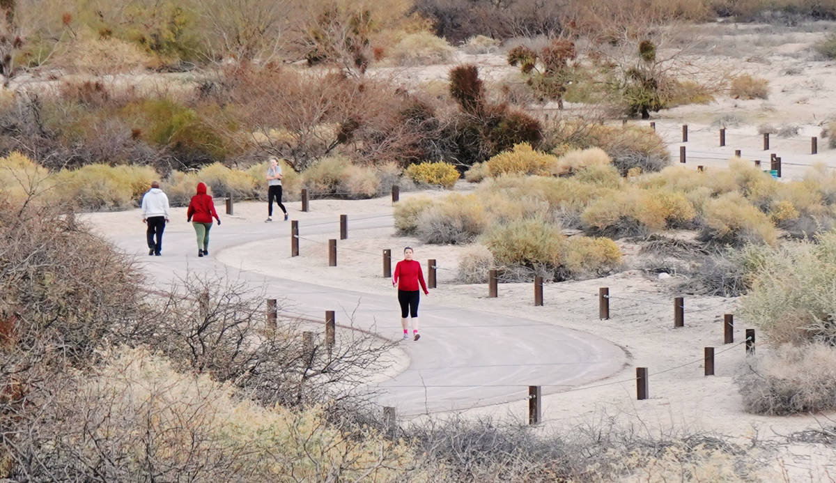 Twelve-foot-wide multi-use trails meander through the dunes area of Sunset Park and have been a ...