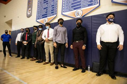 Students participate during a Signing day ceremony at Bishop Gorman High School in Las Vegas, o ...
