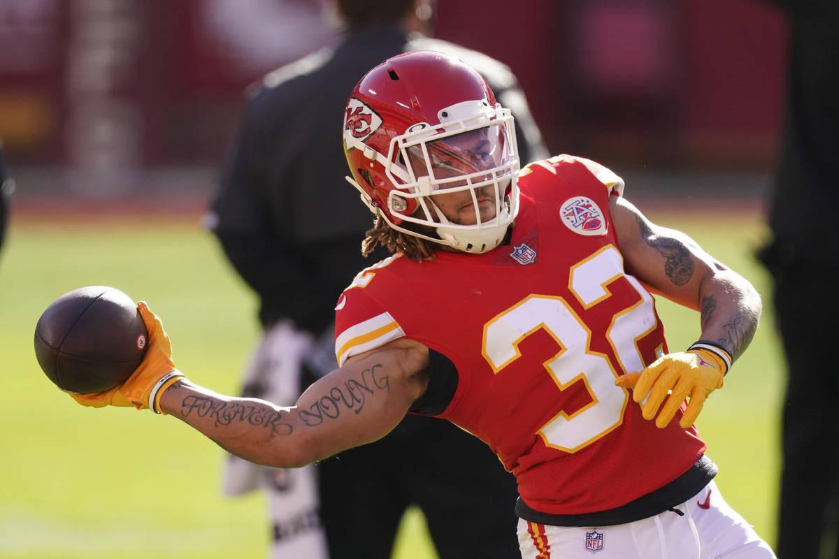 Kansas City Chiefs safety Tyrann Mathieu warms up before an NFL football game against the Atlan ...