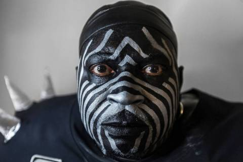"Raiders super fan Wayne Mabry, known as ""Violator,"" in his hotel room at 4 a.m. in Du ..."