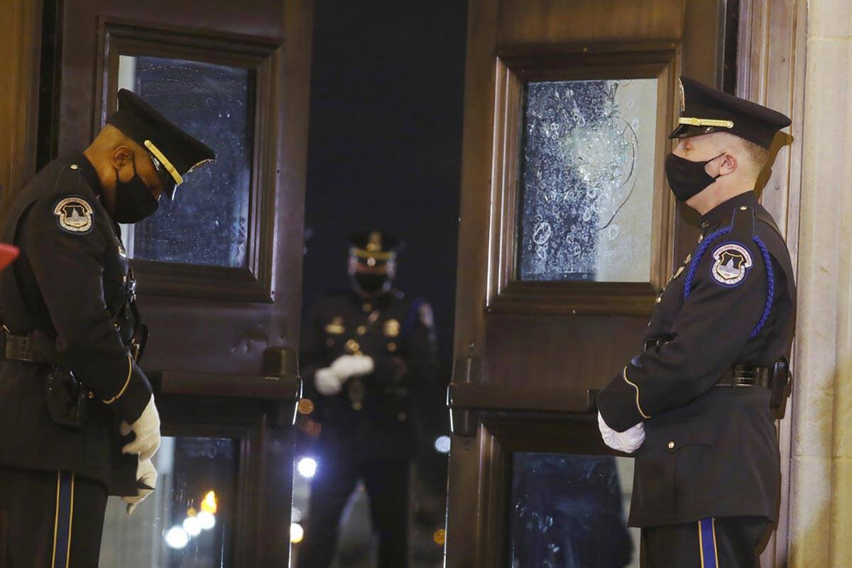 U.S. Capitol Police officers stand guard near the doors of the Capitol Rotunda where the late U ...