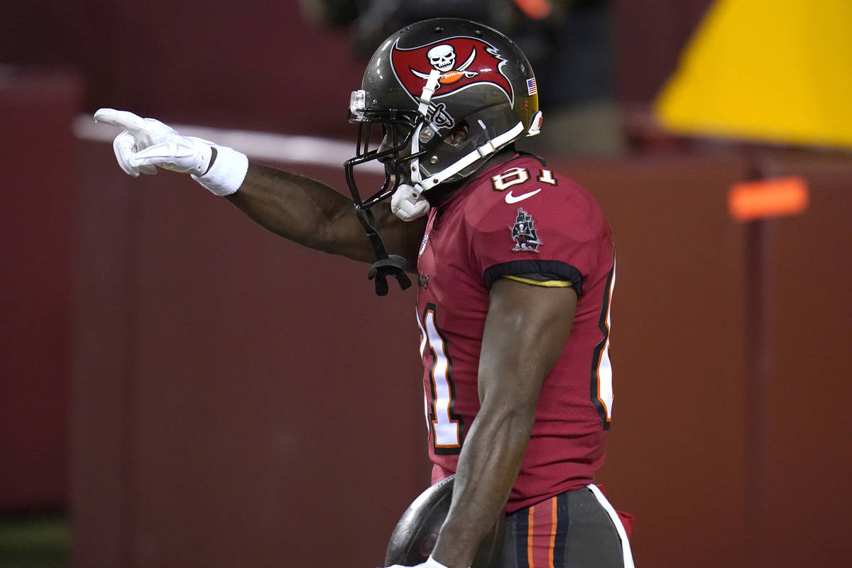Tampa Bay Buccaneers wide receiver Antonio Brown gestures after catching a touchdown pass from ...